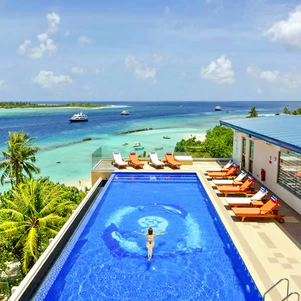 Best Luxury resort ito swim with mantas and whale sharks n Maldives