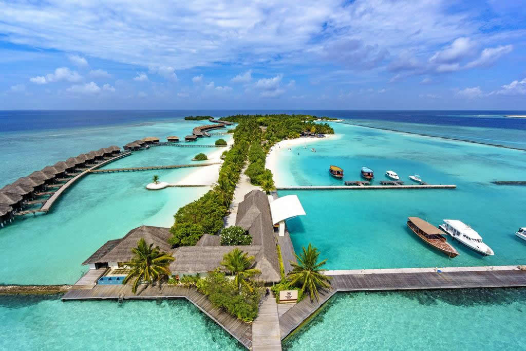 White sands, crystal waters and gold sunshine feature at the luxurious Sheraton Maldives Full Moon Resort & Spa on the private Furanafushi Island.
